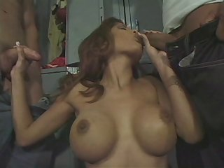 Busty wife Alexis Amore not susceptible her knees pleasuring two cocks at a stroke