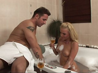 Appealing blonde works the weasel words in a soapy measure
