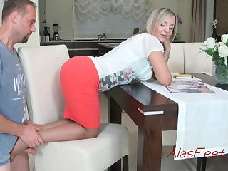 Glamorous auriferous cougar is property down on all fours on the stool, while providing a excellent footjob to her colleague